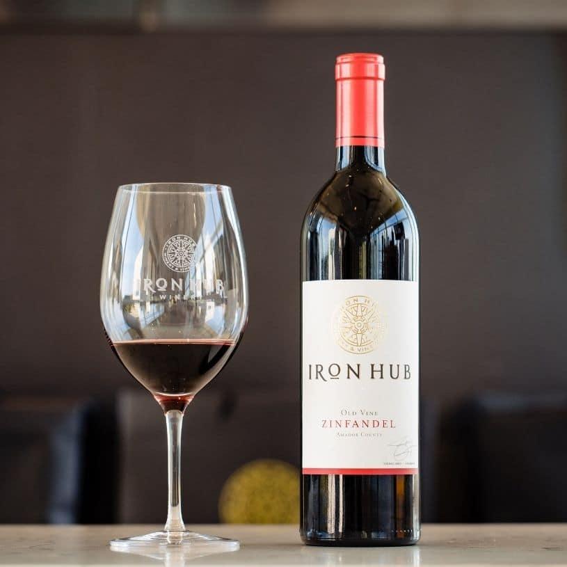 Iron Hub old vine zinfandel wine glass and bottle
