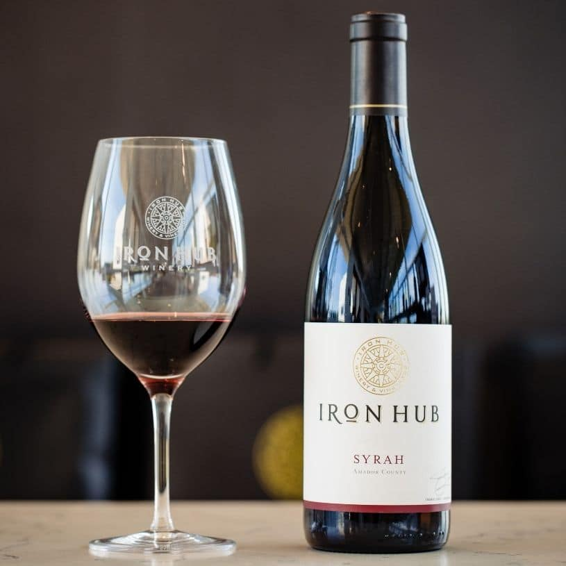 Iron Hub Syrah wine glass and bottle